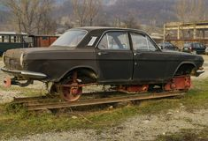 Old car on railroad. This old car was modified to be able to be driven on the railroad system Stock Image