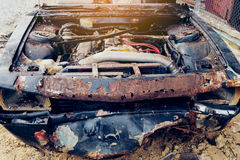 Old car ready to be scrapped,in garage Stock Image