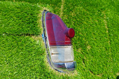 Old car rear lights with artificial grass around Stock Photography
