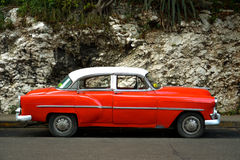 Old car. Old red car in front of National Hotel, the Havana. Cuba royalty free stock photography