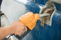 Old car refueling Royalty Free Stock Photo