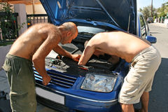 Old car repairing Stock Photos