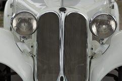 Old car, retro, closeup. Front of old white car, closeup Stock Photos