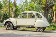 Old car on road in Hanoi, Vietnam on December 12, 2016 royalty free stock photos
