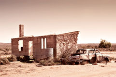 Old car and ruins in outback Stock Photography