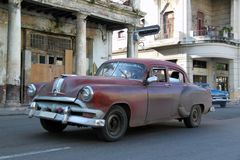 Old car running in Havana 2. Old red car running in a street of Havana, Cuba Stock Images