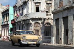Old car running in Havana. Old yellow car running in a street of Havana, Cuba Royalty Free Stock Image