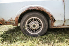 Old car with rust on body. Close up Stock Photos