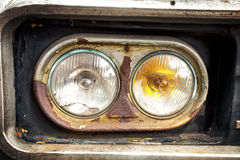 Old car's headlight Stock Images