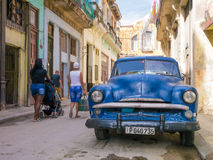 Old car in a shabby street in Havana Royalty Free Stock Photo