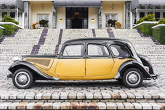Old car, side view. Beautiful yellow/black old car, side view Royalty Free Stock Images
