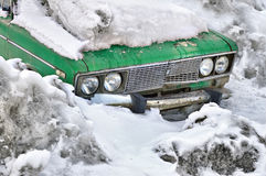 Old car in snow Royalty Free Stock Image