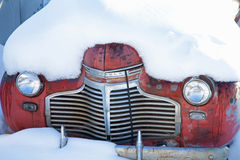 Old car in snow Royalty Free Stock Photography