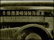 Old Car Speedometer. The weathered speedometer of an old car.  Broken glass with partial view of the gritty dashboard and steering wheel Stock Images