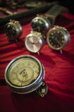 Old car speedometer and table clocks. Some antique items displayed for sale at a flea market stock photography