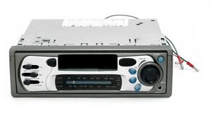 Old car stereo with bare wires Royalty Free Stock Photography