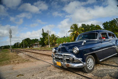 Old car on street in Cuba. An old car on a street by the railroad tracks in Cuba Royalty Free Stock Photos