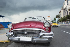 Old car on street of Havana, Cuba on the rainy day Royalty Free Stock Images