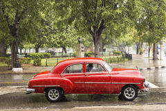 Old car on street of Havana, Cuba on the rainy day Stock Images