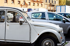 Old car in street of modern city Stock Images