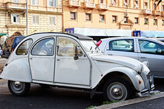 Old car in street of modern city Stock Photos