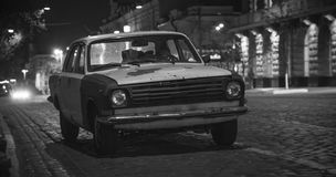 Old car on a street at night Royalty Free Stock Image