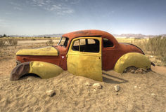 Old car stuck in sand Stock Photography