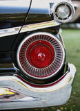Old car tail lights. Old chrome red and white tail lights on car Royalty Free Stock Photography