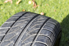 Old car tire outdoor. Stock Photos
