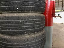 Old car tire pile in the garage. royalty free stock image