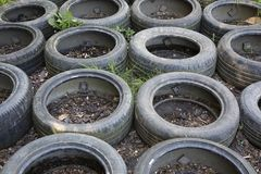 Old car tires used at an obstacle course. A close-up of an obstacle course where old car tires are being used as one of the obstacles royalty free stock photo