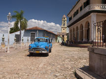 Old car of Trinidad. Old Cuban taxi in transit on the square of Trinidad, a old Cuban city Royalty Free Stock Image