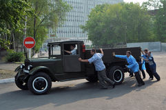 The old car-truck. Men pushing a vintage collection truck Stock Image