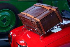 Old car trunk. Red car with suitcase on back side Stock Image