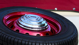Old car tyre. Old ancient car tyre, full of chrome, metallic cherry Royalty Free Stock Image