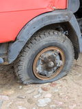 Old car tyre. Old rusty  car with  empty tyre Stock Photos