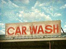 Old car wash sign. Aged and worn photo of old car wash sign Royalty Free Stock Image