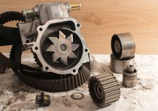 Old Car water pump. Disassembled old automotive water pump with other details Stock Image