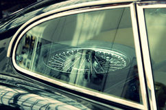 Old car wheel with spokes in the car. Sophistication. Elegance. Vintage style stock photos
