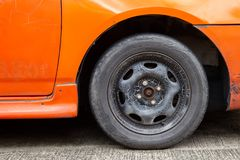 Old car wheels and old tires. It need to be replaced. This may cause an accident on the road stock image