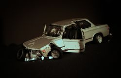 Old car wreck. Metal toy car wreck with low light Stock Photo