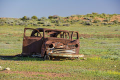 Old car wreck in the middle of the outback of Australia. An old car wreck in the middle of the outback of Australia Royalty Free Stock Photo