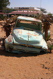 Old car wreck in Namibia. Old car wreck in front of gas station next to the Namibian Desert, Namibia, Southern Africa royalty free stock photography