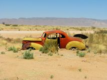 Old car wreck on Namibian desert Royalty Free Stock Photos