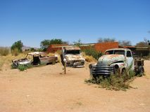 Old car wrecks on Namibian desert Stock Photography