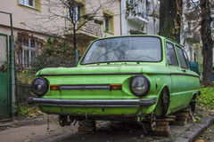 Old car in the yard. Old rusty car without wheels in the yard Royalty Free Stock Photography