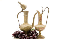 Old carafe with wine grapes Stock Photo