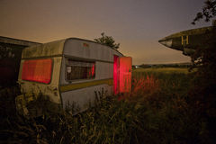 Old caravan in an overgrown field Royalty Free Stock Photo