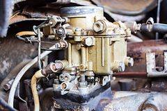 Old carburetor on an car engine Stock Photos