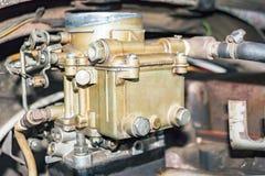 Old carburetor on an car engine. Old carburetor on an Vintage car engine Royalty Free Stock Photo